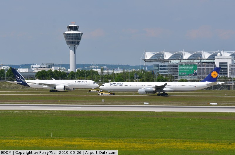 Munich International Airport (Franz Josef Strauß International Airport), Munich Germany (EDDM) - Munchen Airport, tower and part of the terminal and runway in front of the taxyways. View from spotting mount.