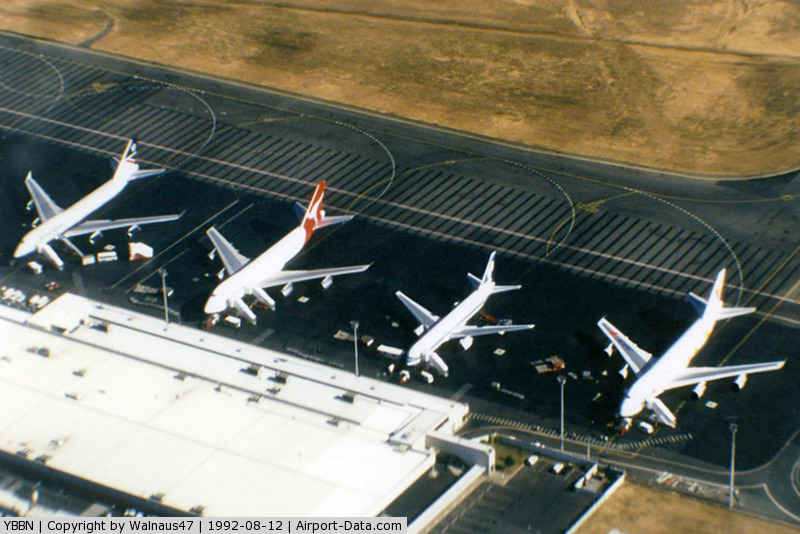 Brisbane International Airport, Brisbane, Queensland Australia (YBBN) - APOV of 'Old Eagle Farm' International Airport YBBN on 12Aug1992. The line-up on the ramp (from front right to left) is a JAL Super Resort Express B747-246B, an Air New Zealand B767, a Qantas B747-338, and a British Airways B747-436.