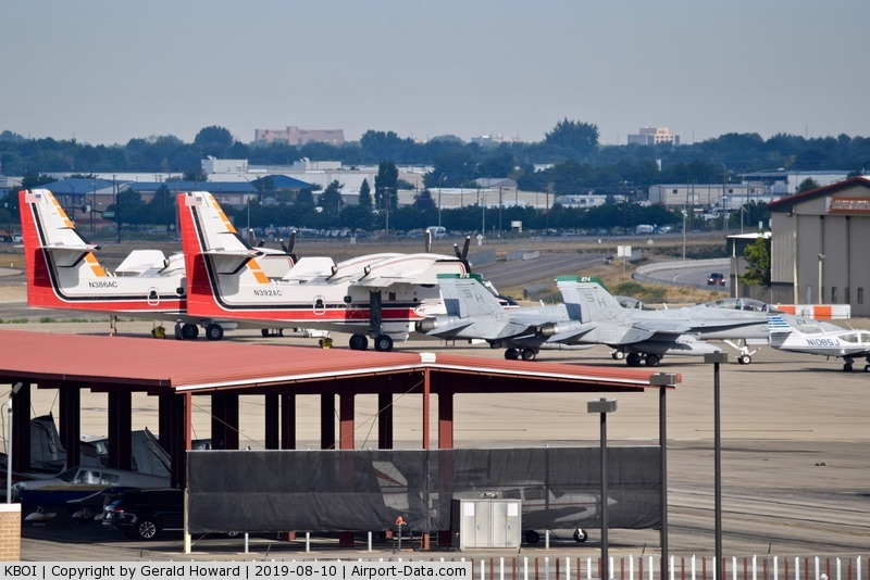 Boise Air Terminal/gowen Fld Airport (BOI) - Two water bombers and two F/A-18Cs parked on the north GA ramp.