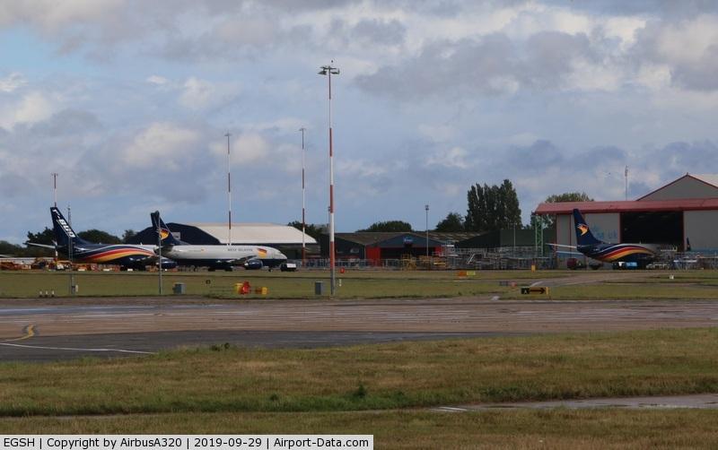 Norwich International Airport, Norwich, England United Kingdom (EGSH) - West Atlantic fleet gather at Norwich 737-800s G-NPTA & G-NPTC (Nose in hangar) joined with a 737-400 G-JMCU