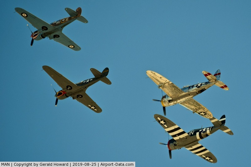 Nampa Municipal Airport (MAN) - P-40s & P-47s over fly MAN during airshow.