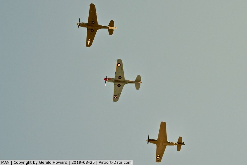Nampa Municipal Airport (MAN) - P-40s and P-51 over fly MAN during airshow.
