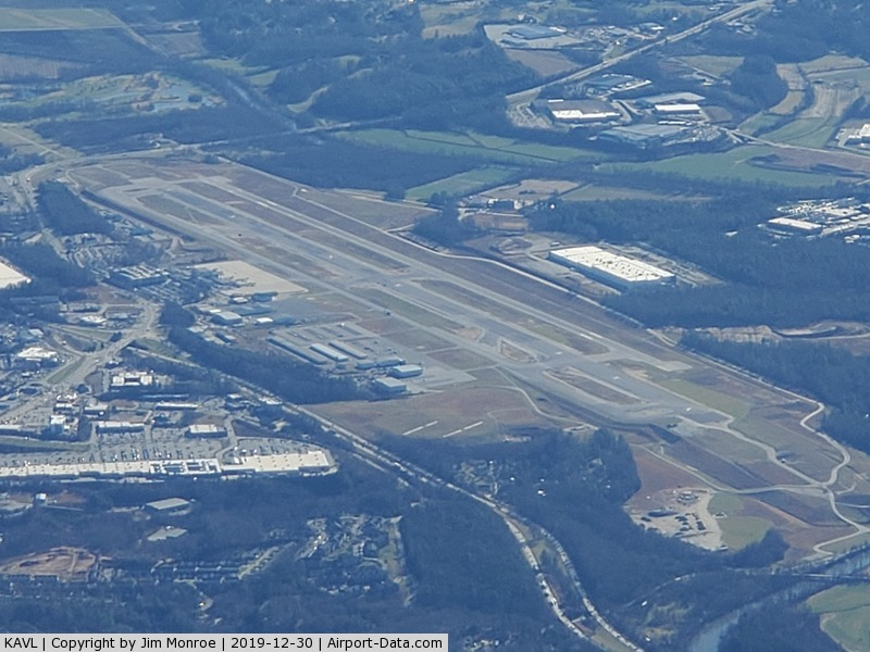 Asheville Regional Airport (AVL) - From 10,000 feet MSL looking south. The FAA determined that the runway was too close to the taxiway. They built a whole new runway (west side), tore up the old runway and built a new one (in the center). This has been in process several years.