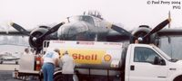 Hampton Roads Executive Airport (PVG) - Hampton Roads Executive's fuel truck servicing a thirsty B-25J - by Paul Perry