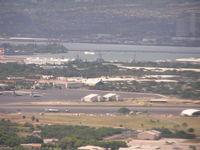 Honolulu International Airport, Honolulu, Hawaii United States (PHNL) - Hickam AFB ramp at Honolulu Intl Airport. Arizona Memorial in background. Taken on final to rnwy 8L - by John J. Boling