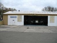 University Airport (EDU) - Davis Air Repair Hangar - by Steve Nation
