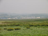 Williamsport Regional Airport (IPT) - Looking across the airport grounds from west to east.  Look closely and you can see a B-17 taxiing out for takeoff. - by Sam Andrews