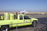Byron Airport (C83) - Airport truck and visiting plane - by Bill Larkins