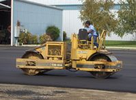 Santa Paula Airport (SZP) - Grading newly resurfaced asphalt aircraft ramp - by Doug Robertson