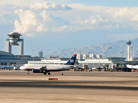 Mc Carran International Airport (LAS) - McCarran's ATCT and the Stratosphere - by Brad Campbell