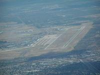Davis Monthan Afb Airport (DMA) - Davis Monthan AFB. Part of aircraft Boneyard visable left center of photo. - by John J. Boling