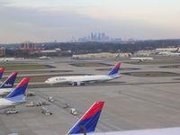 Hartsfield - Jackson Atlanta International Airport (ATL) - Downtown Atlanta in background - by Florida Metal