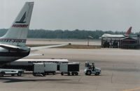 Detroit Metropolitan Wayne County Airport (DTW) - Northwest 747-200 departs in background 1988 - by Florida Metal
