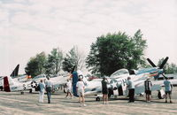 Willow Run Airport (YIP) - P-51s lined up - by Florida Metal