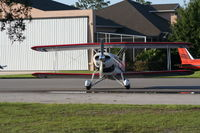 Spruce Creek Airport (7FL6) - Bi plane with private hangars in background - by Florida Metal
