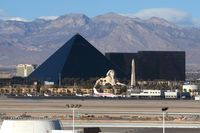 Mc Carran International Airport (LAS) - Looking west from the airport's main parking structure, you get a nice view of the Luxor Hotel & Casino and the mountains. - by Dean Heald