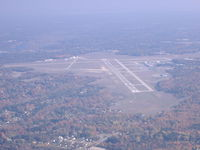 Muskegon County Airport (MKG) - MKG looking east from over the water - by John Woody