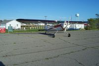 Tangier Island Airport (TGI) - C140 at the edge of parking lot. - by Robert Thomas