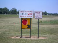 Galveston Airport (5I6) - Signs at the edge of the grass strip - no FBO building. - by IndyPilot63