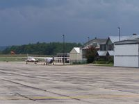 Rutland - Southern Vermont Regional Airport (RUT) - Taken on the tie down area. This is the Backside of the terminal. In the distance you can see the Civil Air Patrol hangars. - by Frank Wulff III