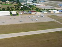 Cherry Capital Airport (TVC) - The building with the maroon roof is the FBO (Harbour Air) - office is on the opposite side. - by Bob Simmermon