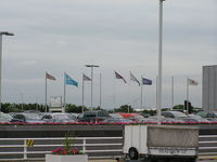 London Heathrow Airport, London, England United Kingdom (EGLL) - Airline Flags outside Terminal 4 at Heathrow - by John J. Boling