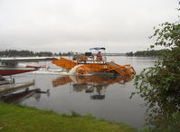 Lake Hood Seaplane Base (LHD) - Lake Hood SPB's water weed cutter/scooper at work keeping clear taxi lanes - by Doug Robertson