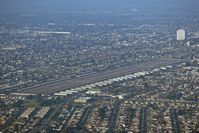 Compton/woodley Airport (CPM) - Entering the traffic pattern at Compton for landing on RWY 25L as seen from our Cessna 172 N62531. - by Dean Heald