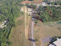 Darr Field Airport (NC03) - crossing overhead the field - by Tom Cooke