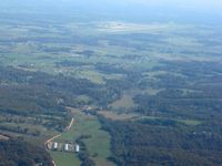 Northwest Arkansas Regional Airport (XNA) - Looking SE from 3500' and about 15nm - by Bob Simmermon