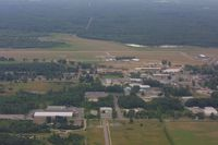 Gladwin Zettel Memorial Airport (GDW) - Left downwind for Rwy 9 over downtown Gladwin - by Tom Hermann