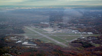 Laurence G Hanscom Fld Airport (BED) - Hanscom fm the W at 3000 MSL, Boston in distance - by Stephen Amiaga
