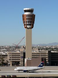 Phoenix Sky Harbor International Airport (PHX) - Good definition of scale between the A319 and the new control tower. The crane in the background is dismantling the old tower. - by John Meneely