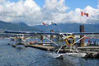 Vancouver Harbour Water Airport (Vancouver Coal Harbour Seaplane Base), Vancouver, British Columbia Canada (CXH) - Harbour Air seaplanes at Coal Harbour (Vancouver Downtown) - by Michel Teiten ( www.mablehome.com )