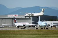 Vancouver International Airport, Vancouver, British Columbia Canada (YVR) - DHC-8 landing while one 767 and one A340 are waiting for take-off - by Michel Teiten ( www.mablehome.com )