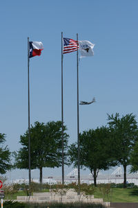 Fort Worth Alliance Airport (AFW) - Flags at the entrance to Alliance Ft. Worth - by Zane Adams