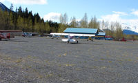 Girdwood Airport (AQY) - Looking on the North parking apron and Alpine Air helicopter facility - by Terry Fletcher