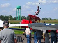Fairfield County Airport (LHQ) - Wing walking act at Wings of Victory airshow - Lancaster, Ohio - by Bob Simmermon