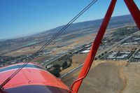 Livermore Municipal Airport (LVK) - Right base to final for 25R at KLVK as viewed from Attitude Aviation's Great Lakes - by B. Hermann