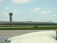 James M Cox Dayton International Airport (DAY) - Several towers on this airport-this is NOT the Air Traffic Control Tower. From N2111Q Beech BONANZA 36 taxiing in - by Doug Robertson