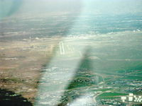Albuquerque International Sunport Airport (ABQ) - Rainy descent to Rwy 26 in N2111Q Beech BONANZA 36 - by Doug Robertson