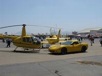Camarillo Airport (CMA) - Yellow Toys for Big Boys at EAA Annual Airshow - by Doug Robertson