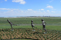 Dallas/fort Worth International Airport (DFW) - Flying kids statues at the new Founders Plaza airport viewing area at DFW - by Zane Adams