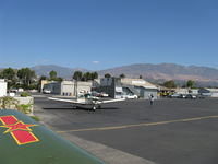 Santa Paula Airport (SZP) - Taxi past mid-field self-service fuel dock, CP Aviation FBO beyond. - by Doug Robertson
