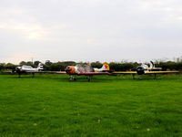 Little Gransden Airfield - Yaks galore. from left to right G-CBMI, G-BWOD, G-YYAK - by chris hall
