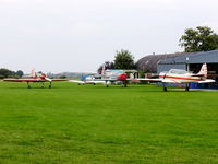Little Gransden Airfield - lots of Yak's. from left to right, RA-02209, G-CCCP, G-BVOK - by chris hall