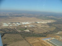 Denton Municipal Airport (DTO) - Looking midfield while left downwind for Rwy 17 - by B.Pine