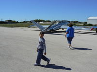 Lago Vista Tx - Rusty Allen Airport (RYW) - Mr Dill and a freind looking at the Jets - Lago Vista Airport - by Zane Adams