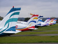 Panshanger Airport - Colourful tails of the East Herts Flying School - by chris hall
