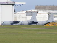 Cambridge Airport - Two ex RAF C-130's awaiting their fate at Marshalls of Cambridge - by chris hall